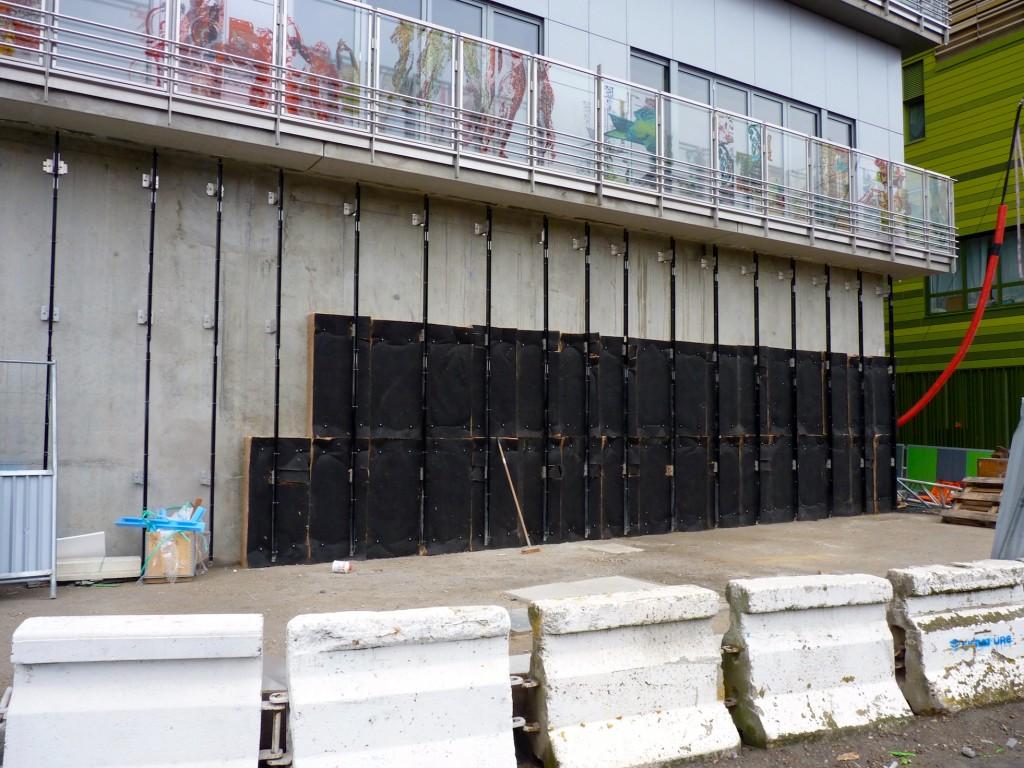 Pose des isolants, rez-de-chaussée, bâtiment C